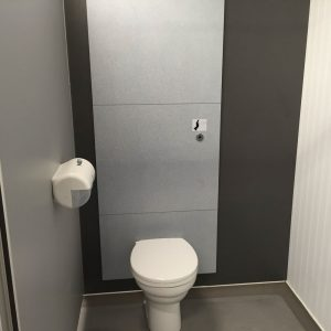 Staff toilet cubicle at a food factory in Bow London