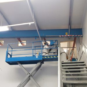 Food Sector Construction employee carrying out building maintenance and repair work on in a food factory.