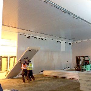 Food Sector Construction staff installing hygienic walls