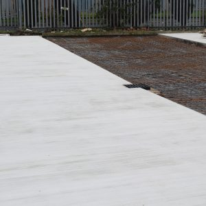 Brush finished concrete mid project.