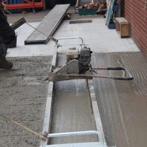 Concrete leveller levelling out concrete